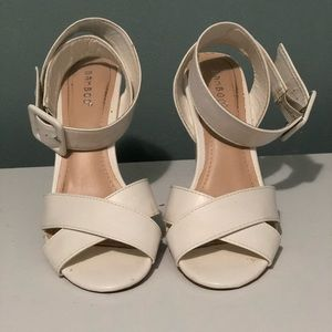 "White faux leather heels. Heel is about  3""1/2'"